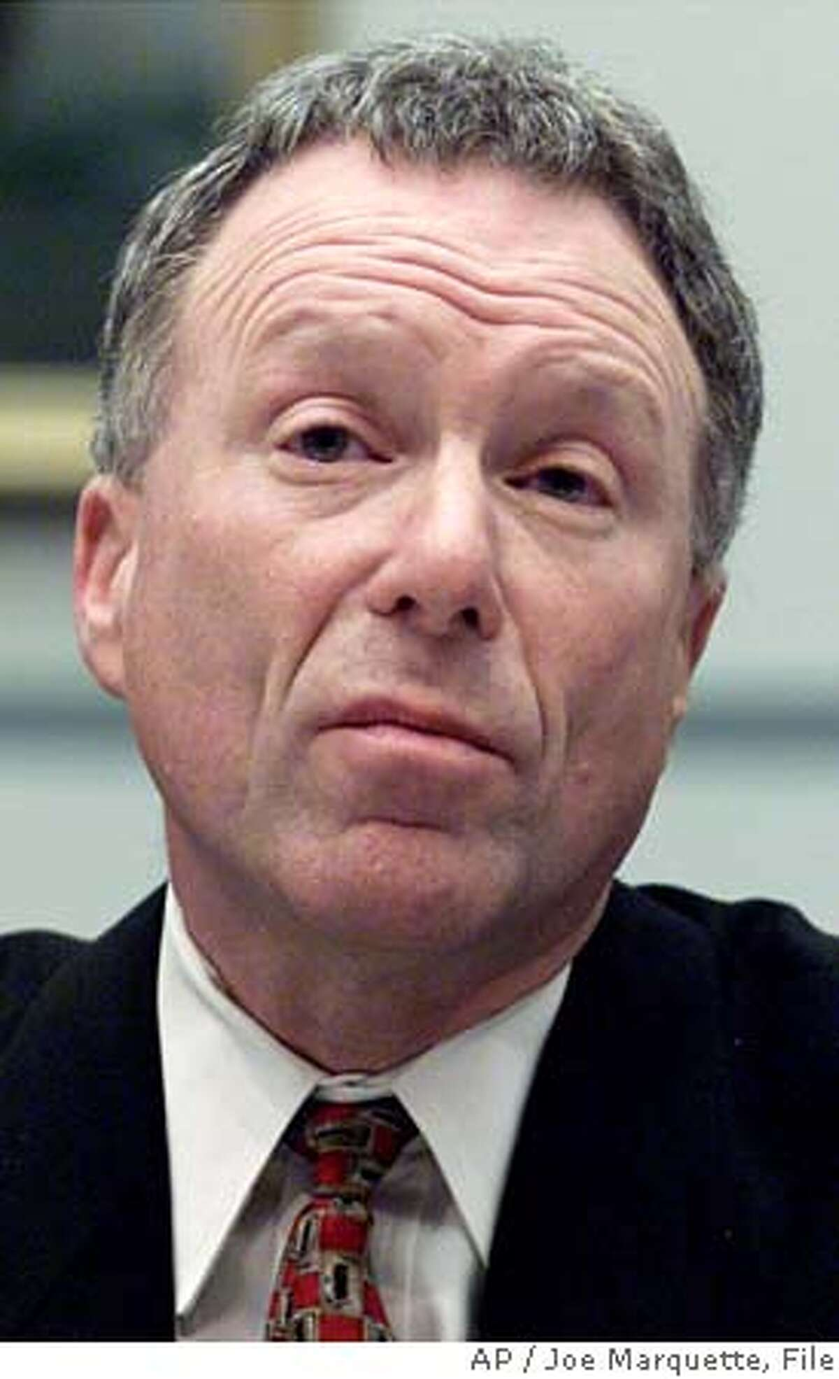** FILE ** Lewis Libby testifies during a House Government Reform Committee hearing in this Thursday, March 1, 2001 file photo, in Washington. Libby was a source along with President Bush's chief political adviser for a Time story that identified a CIA officer, the magazine reporter said Sunday, July 17, 2005, further countering White House claims that neither aide was involved in the leak. (AP Photo/Joe Marquette) MARCH 1, 2001 FILE PHOTO
