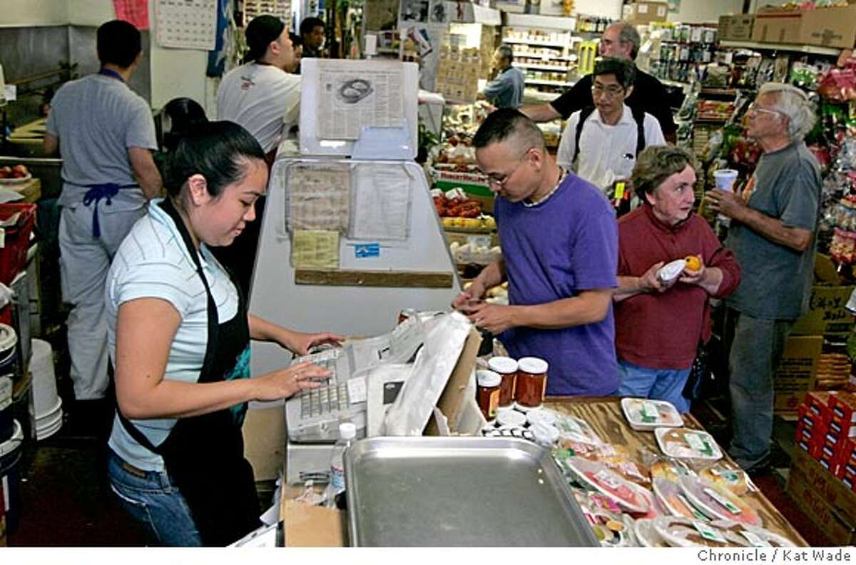 On 7/13/05 in Berkeley at the Tokyo Fish Market, co-owned by Lee Nakamura and Larry Fujita (NOT PICTURED) which has been in business on San Pablo Ave. in Berkeley for 42 years is expanding due to their loyal following of both Japanese Americans and non-Asians alike who love the food. Larry Fujita's neice Kristi Lozano, rings up customers (L TO R) Dale Chung, Tak Nakamoto, Dan Lynch, Shirley and Dan Dean. Kat Wade/ The Chronicle