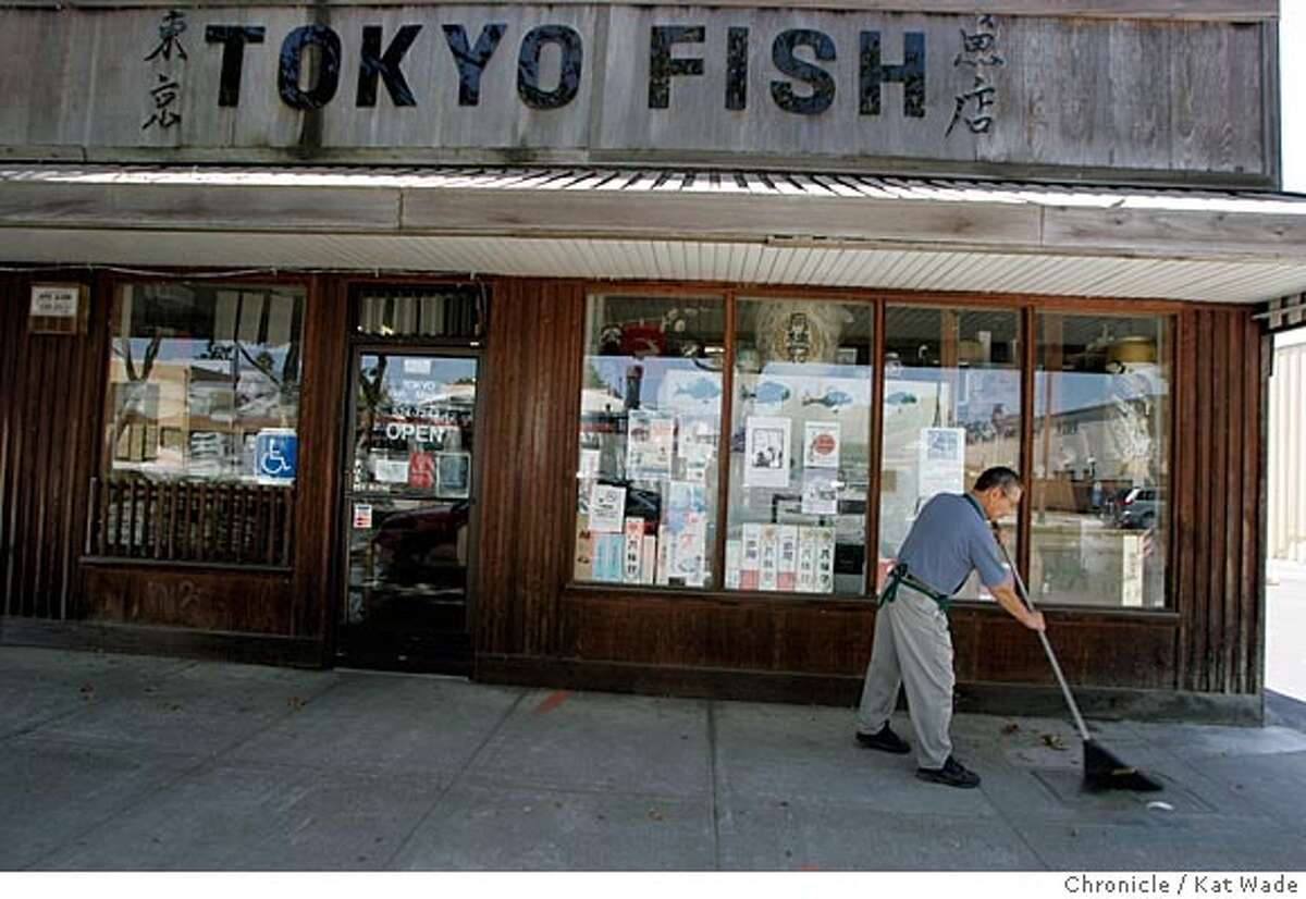 On 7/13/05 in Berkeley at the Tokyo Fish Market, (L to R) employee Hide Abe (CQ) sweeps the sidewalk in front of the old location at the business so successful in its 42 years on San Pablo Ave. that it is expanding due to their loyal following of both Japanese Americans and non-Asians alike who love the food. Kat Wade/ The Chronicle