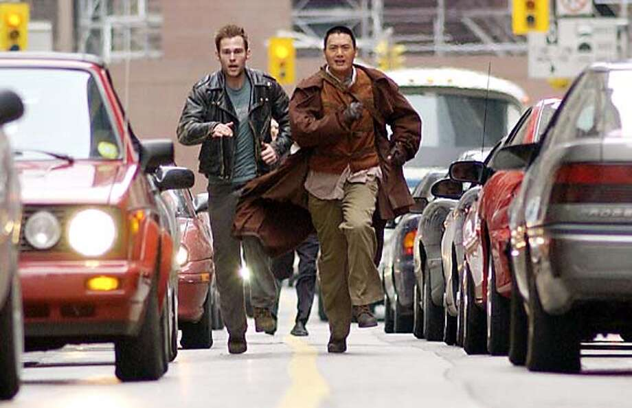 """Seann William Scott, left, and Chow Yun-Fat in """"Bulletproof Monk."""" Photo by George Kraychyk"""