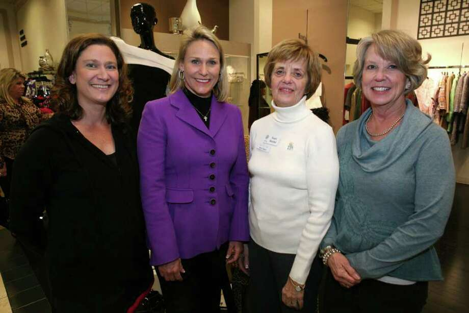 "Guest Carole Miller, from  left, member Peggy Hughes, board member Dawn Canavit and former  President Jenny O'Connor gather during the Zeta Tau Alpha Alumnae  Chapter of San Antonio's ""Passion for Fashion"" fundraiser at Julian  Gold. Photo: For The Express-News, Leland A. Outz / SAN ANTONIO EXPRESS-NEWS"