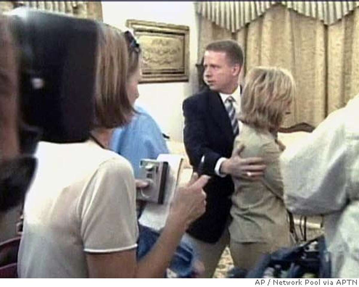 ** RETRANSMITTED TO CORRECT SPELLING OF SUDANESE PRESIDENT'S NAME IN SECOND REFERENCE ** In this frame from video, an unidentified Department of State official helps shield NBC correspondent Andrea Mitchell after Sudanese security guards had grabbed her, pushing her towards the rear of the room where Secretary of State Condoleezza Rice was meeting with Sudanese President Omar el-Bashir Thursday, July 21, 2005, in Khartoum, Sudan. All reporters and a camera crew were physically forced from the room as Rice and el-Bashir watched. (AP Photo/Network Pool via APTN)