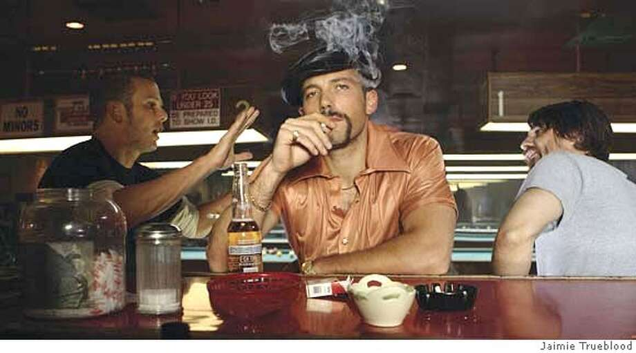 (L to R) Bounty hunters ?Pistol? Pete Deeks (PETER BERG), Jack Dupree (BEN AFFLECK) and Hollis Elmore (MARTIN HENDERSON) discuss their quarry in a dark action comedy about the interlocking tales of high stakes and low lifes, Smokin' Aces. Smokin' Aces will be released in theaters on January 26, 2007.  Photo Credit: Jaimie Trueblood Photo: Photo Credit: Jaimie Trueblood