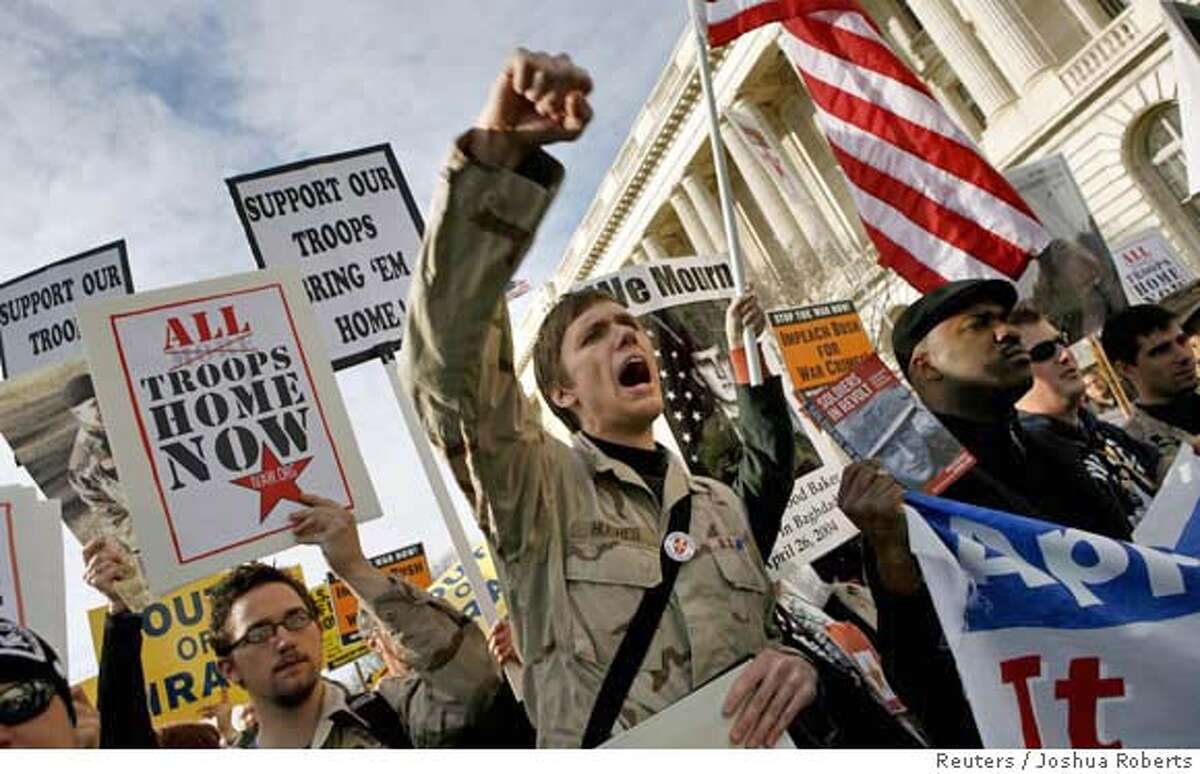 An anti-war demonstrator protests the war in Iraq as thousands of protesters march around the U.S. Capitol in Washington, January 27, 2007. REUTERS/Joshua Roberts (UNITED STATES) 0