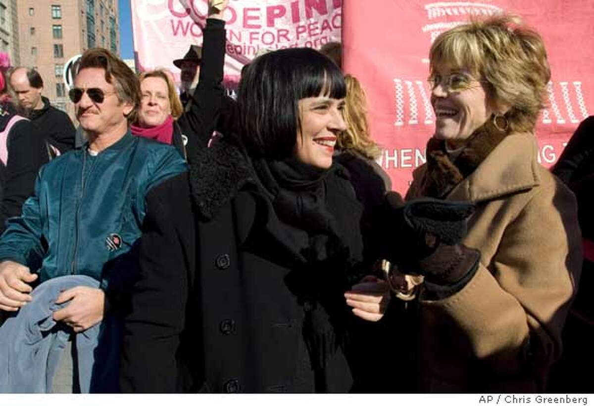 Actress Jane Fonda, right, smiles with Eve Ensler, author of 'The Vagina Monologues,' center, at the U.S. Navy Memorial as they participate in a protest against the war in Iraq, Saturday Jan. 27, 2007, in Washington. Actor Sean Penn can be seen at left. (AP Photo/Chris Greenberg)