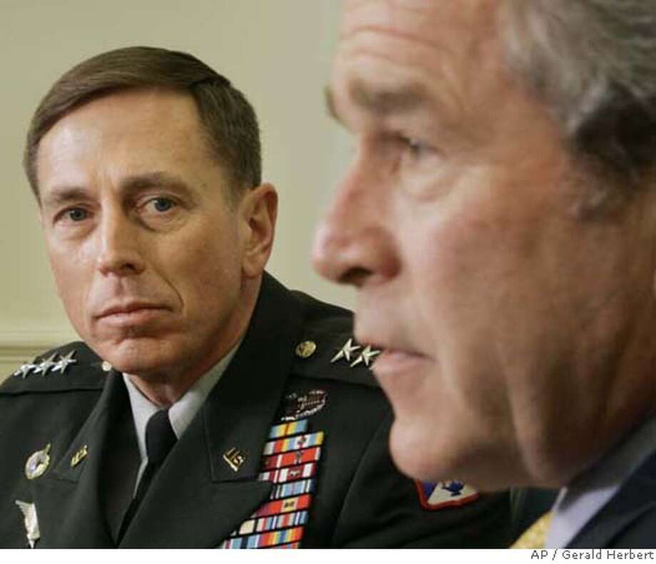 President Bush, right, meets with Gen. David H. Petraeus, the incoming Commander of Multi-National Force, Friday, Jan. 26, 2007 in the Oval Office of the White House in Washington. (AP Photo/Gerald Herbert) Photo: GERALD HERBERT