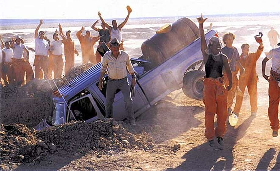 "THIS IS A HANDOUT IMAGE. PLEASE VERIFY RIGHTS. The kids cheer when Mr. Sir's, played by Jon Voight, truck is driven into a hole, from the movie ""Holes,"" directed by Andrew Davis.  (HANDOUT PHOTO) Photo: HANDOUT"
