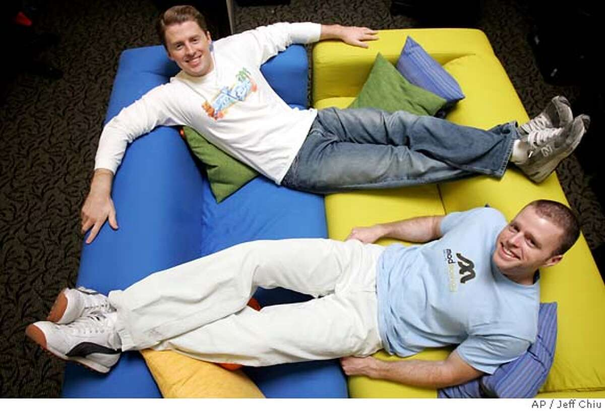 **HOLD FOR STORY MOVING 9:01 p.m. PDT Sunday July 17** Zazzle co-founders Jeff Beaver, 25, top, and his brother Bobby, 27, are photographed at their office in Palo Alto, Calif., Thursday, July 14, 2005. Zazzle, a startup that makes customized T-shirts, posters and postage stamps, has built a library of 500,000 digital images, including more than 3,500 items of copyrighted material licensed from Walt Disney Co.'s treasure trove of pop culture icons like Mickey Mouse and Goofy. (AP Photo/Jeff Chiu) HOLD FOR STORY MOVING 9:01 P.M. PDT SUNDAY JULY 17
