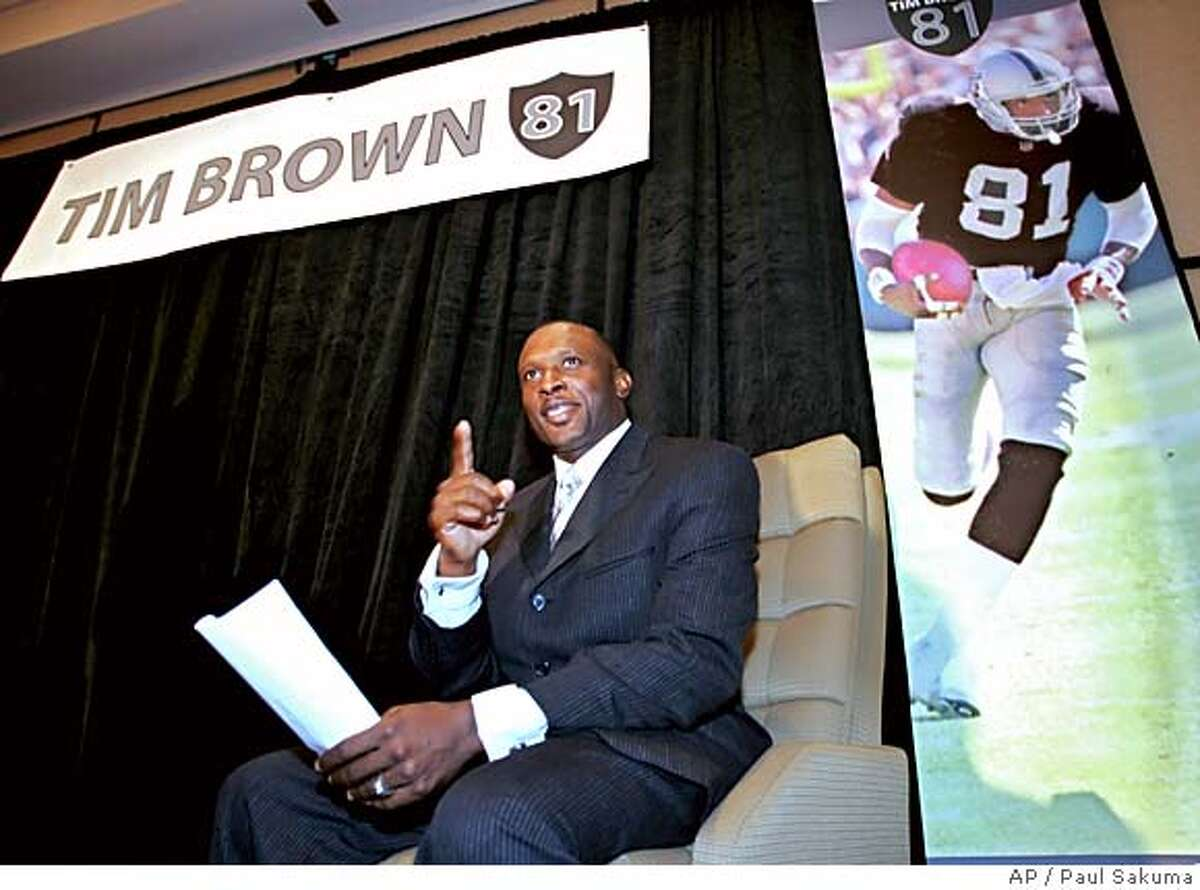 Tim Brown smiles at a news conference in Oakland, Calif., Monday, July 18, 2005 before he announced his retirement from the NFL. Brown signed a one-day contract with the Oakland Raiders so he can retire as a Raiders. Brown played last season with the Tampa Bay Buccaneers. (AP Photo/Paul Sakuma)