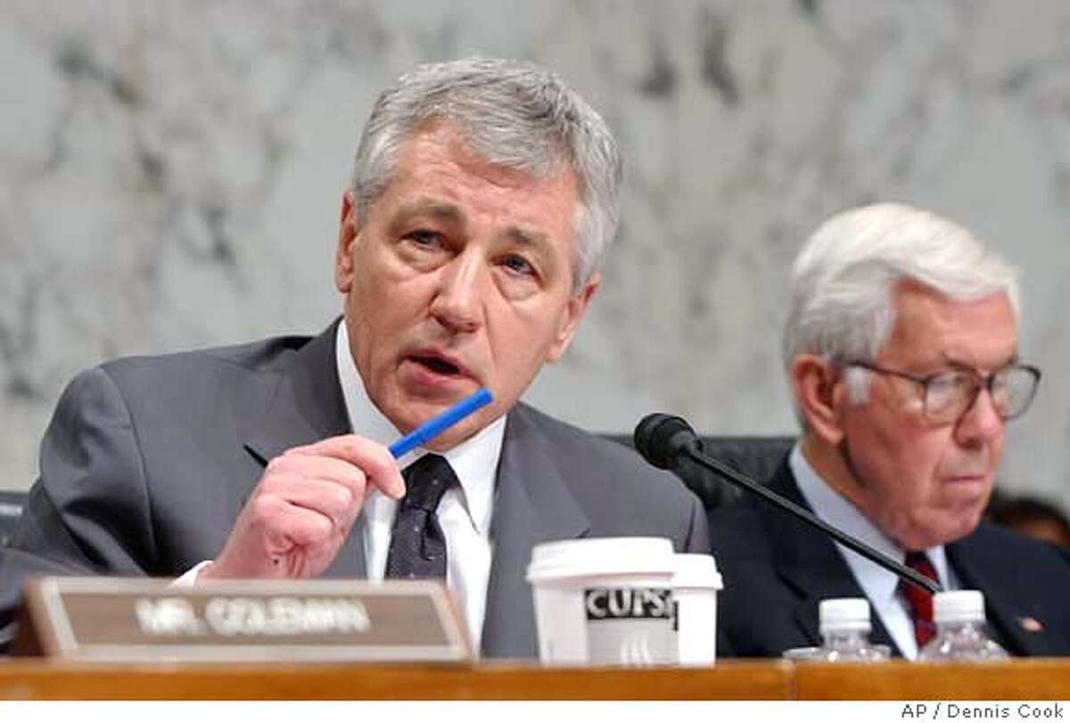 Senate Foreign Relations Committee members, Sen. Chuck Hagel, R-Neb., left, and Sen. Richard Lugar, R-Ind., take part in a debate on a Iraq War resolution, Wednesday, Jan. 24, 2007 on Capitol Hill in Washington. (AP Photo/Dennis Cook)
