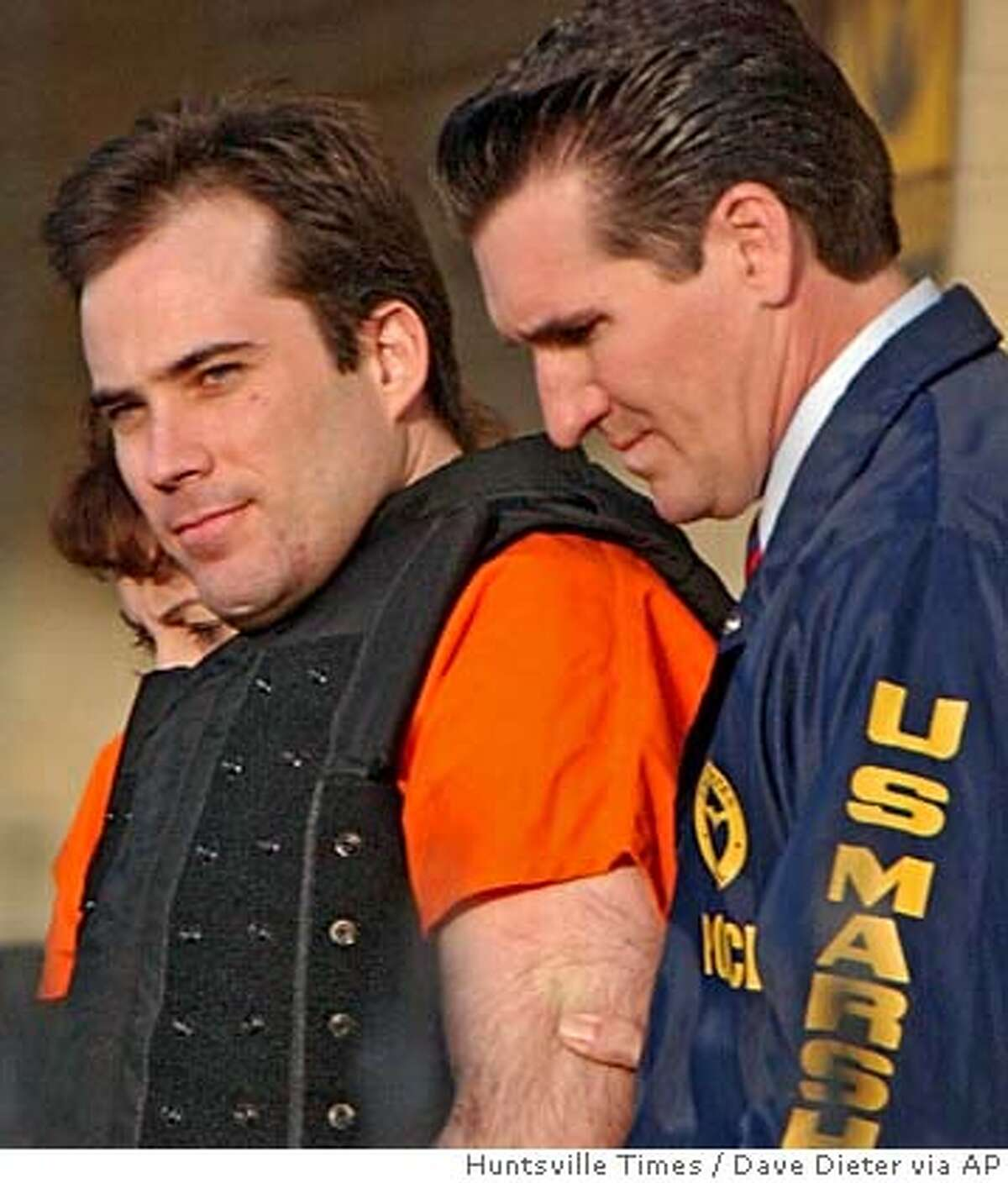 **FILE**This is a March 29, 2005 file photo of Eric Rudolph being led by authorities from a federal courthouse in Huntsville, Ala. Rudolph, who admitted setting deadly explosions in Birmingham and Atlanta, faces sentencing hearing Monday, July 18, 2005. (AP Photo/Huntsville Times, Dave Dieter) THIS IS A MARCH 29, 2005 FILE PHOTO.