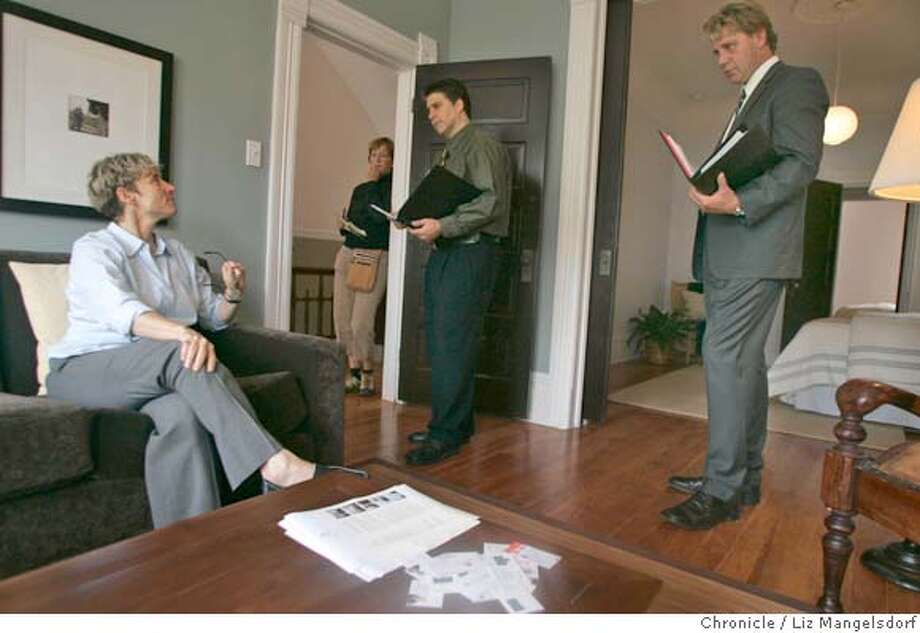 homes20_009_lm.JPG Event on 7/19/05 in San Francisco.  Michael Whalen, right, talks with Julie Rogers, on couch, an agent for Domicile Properities, who is showing the home on Waller street that Whalen is interested in putting a bid on. In the center of the photo is Realtor Greg Court, who is looking at the property with a client. Story on monthly home sales stats. We visit open homes.  Liz Mangelsdorf / The Chronicle MANDATORY CREDIT FOR PHOTOG AND SF CHRONICLE/ -MAGS OUT Photo: Liz Mangelsdorf