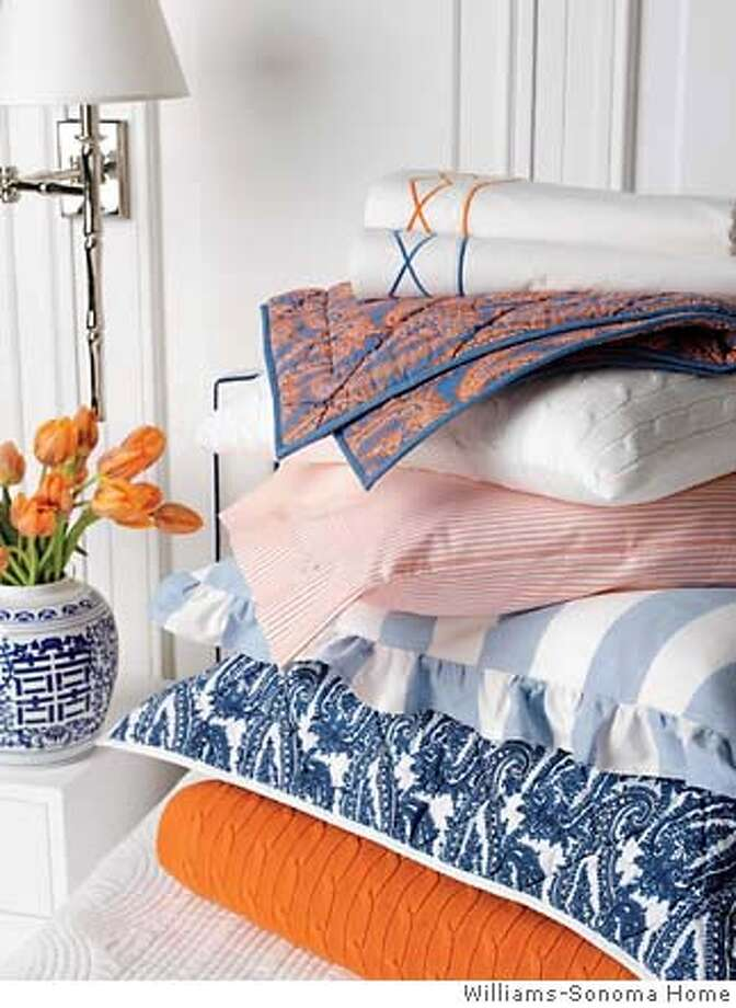 Williams Sonoma's Everyday Luxury bedding line features the colors of blue and orange, in crisp, 230-thread-count percale, at $198 for a queen sheet set. Quilts and duvet covers also retail for $198.  Ran on: 01-21-2007 Photo: Handout