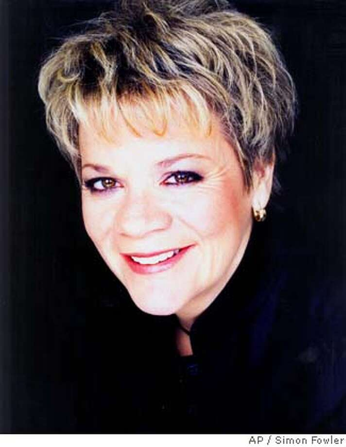 **FILE**This undated file image, originally released by Amsterdam's Royal Concert Hall Orchestra in March 2005, shows conductor Marin Alsop, the first woman ever to conduct the orchestra. Alsop, an American considered one of the world's top female conductors, is expected to be appointed music director of the Baltimore Symphony Orchestra, her publicist said Friday, July 15, 2005. Alsop is currently pricipal conductor at the Bournemouth Symphony Orchestra in Britain. (AP Photo/Royal Concert Hall Orchestra,Simon Fowler) , UNDATED, EDITORIAL USE ONLY Photo: SIMON FOWLER