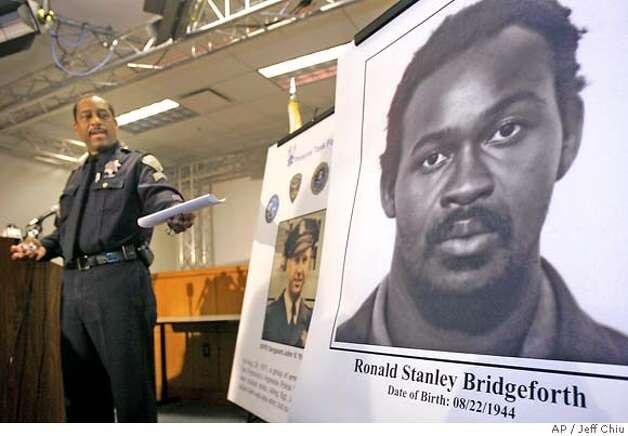 San Francisco Police Sergeant Neville Gittens points to a photograph of suspect Ronald Bridgeforth, far right, at a news conference in San Francisco, Tuesday, Jan. 23, 2007. Eight men were arrested Tuesday in the 1971 killing of San Francisco police officer John V. Young that authorities say was part of a black power group's five-year effort to attack and kill law enforcement officers in San Francisco and New York. Police said all eight are believed to be former members of the Black Liberation Army, a violent offshoot of the Black Panther Party. (AP Photo/Jeff Chiu) Photo: Jeff Chiu