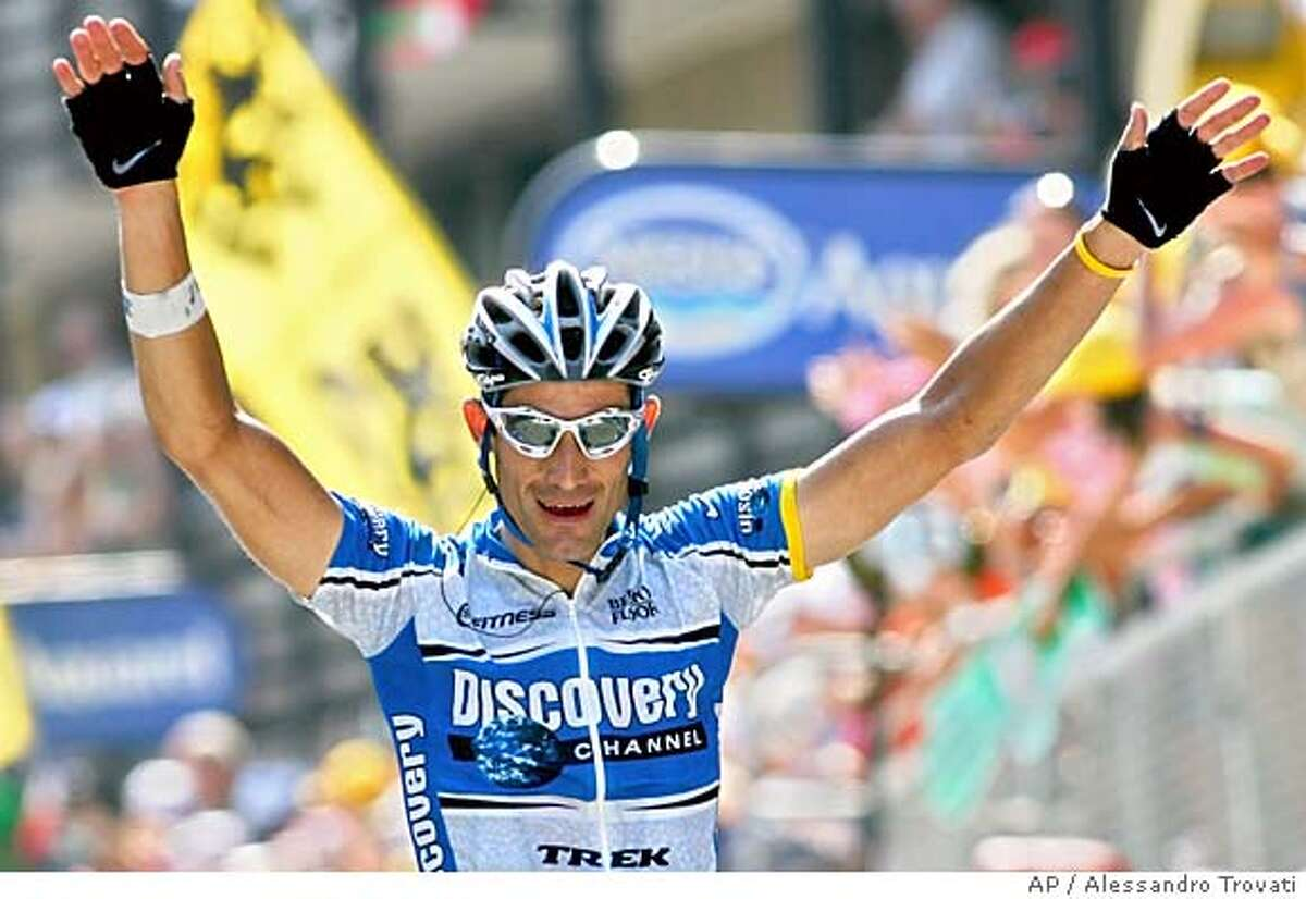 George Hincapie of the U.S. reacts as he crosses the finish line to win the 15th stage of the Tour de France cycling race between Lezat-sur-Leze, southwestern France, and Saint-Lary-Soulan, Pyrenees mountains, Sunday, July 17, 2005. (AP Photo/Alessandro Trovati)