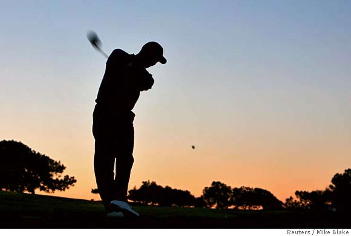 Tiger Woods tees off the second hole as he takes part in the Pro-Am at the Buick Invitational golf tournament at Torrey Pines in La Jolla, California January 24, 2007. REUTERS/Mike Blake (UNITED STATES) 0