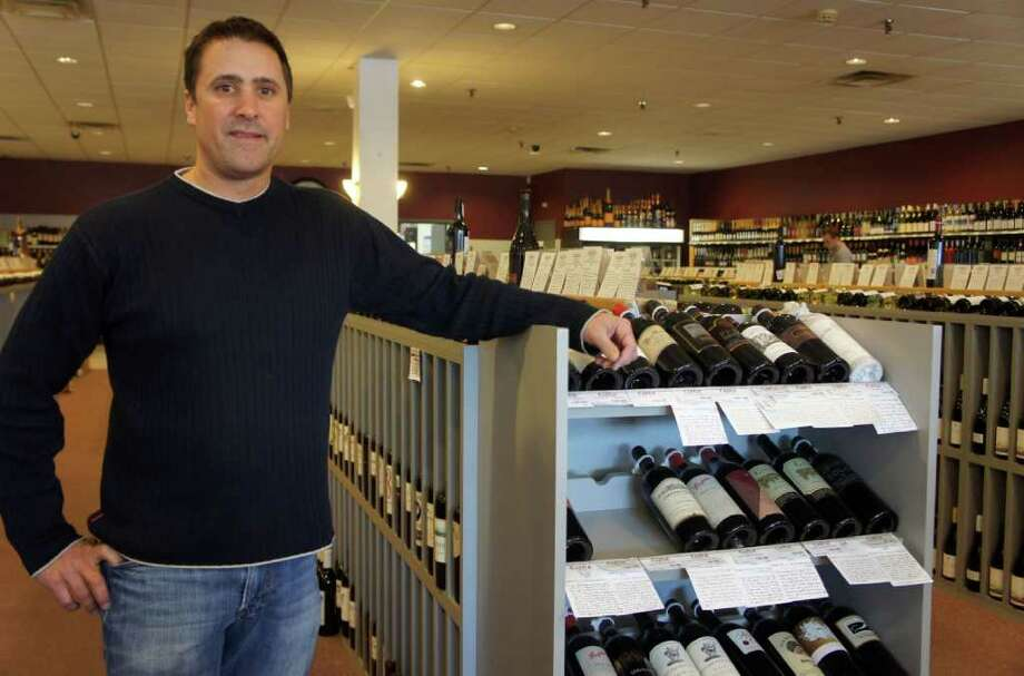 Chris Vellozzi, owner of Castle Wine & Spirits, stands in his store at 1439 Post Road East in Westport on Friday, Jan. 20, 2012. Photo: Paul Schott / Westport News
