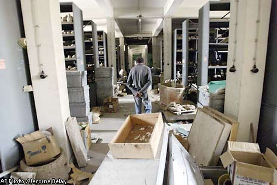 An Iraqi civilian walks through the vault of the National Museum in Baghdad, Iraq Saturday April 12, 2003. Looters opened the museum vault, went on a rampage breaking ancient artifacts stored there by museum authorities before the war started. (AP Photo/Jerome Delay) Photo: JEROME DELAY