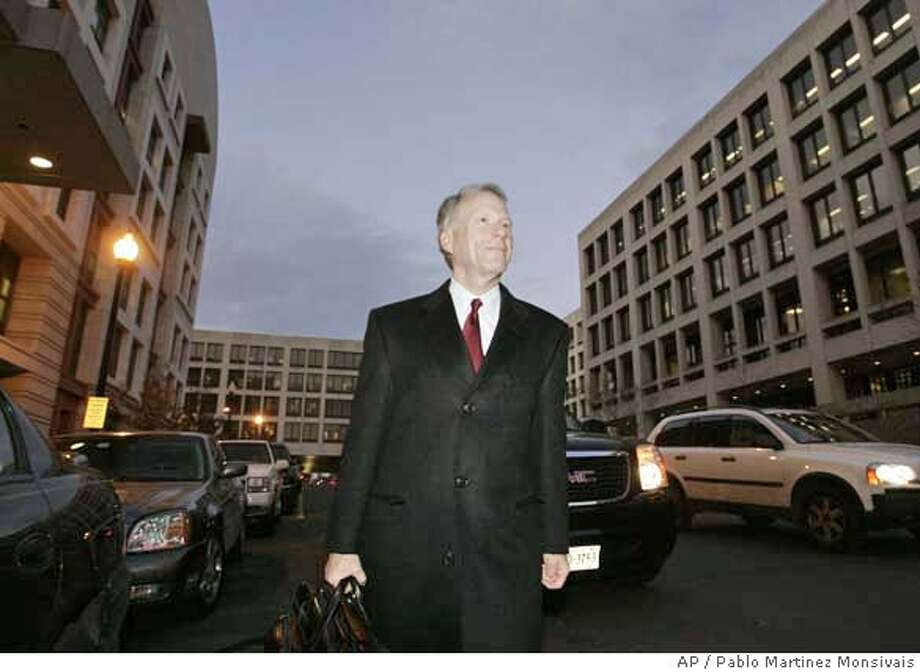 I. Lewis Scooter Libby, former chief of staff for Vice President Dick Cheney, walks to a waiting cab as he leaves U.S. Federal Court, Tuesday, Jan. 23, 2007 in Washington. (AP Photo/Pablo Martinez Monsivais) Photo: PABLO MARTINEZ MONSIVAIS
