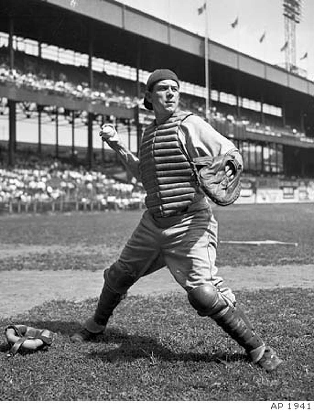 ** FILE ** Brooklyn Dodgers catch Mickey Owen is shown in this Sept. 1941 file photo in New York. Owen, whose infamous dropped third strike proved costly to the Dodgers in the 1941 World Series against the New York Yankees, died Wednesday, July 13, 2005, after a long illness. Owen, 89, died at the Missouri Veterans Home in Mount Vernon, Mo. (AP Photo) A SEPT. 1941 B&W FILE PHOTO