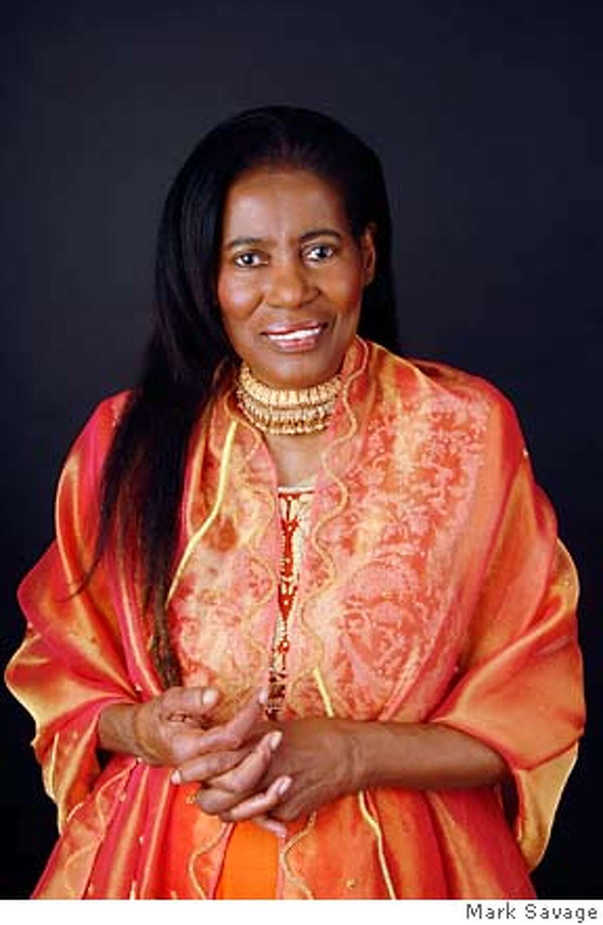 Alice Coltrane, 69, jazz pianist, harpist and the widow of John Coltrane, photographed October 12, 2006 at the John Coltrane Foundation in Woodland Hills, CA Copyright 2006 Mark Savage photo: Mark Savage www.MarkSavage.com marksavagephoto@aol.com 310-367-4706