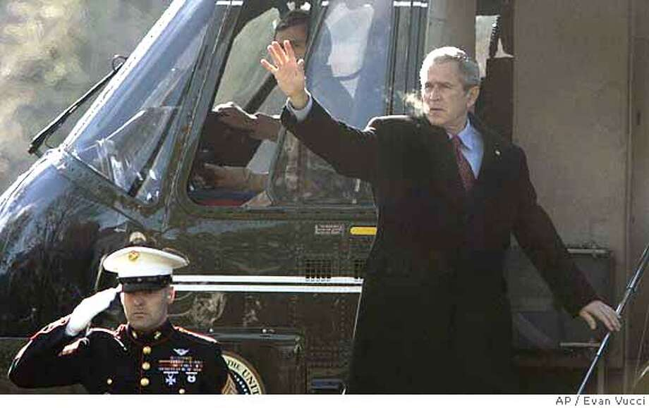 President Bush waves as he boards Marine One to travel to Camp David for the weekend on Saturday, Jan. 20, 2007 in Washington. (AP Photo/Evan Vucci) Photo: EVAN VUCCI