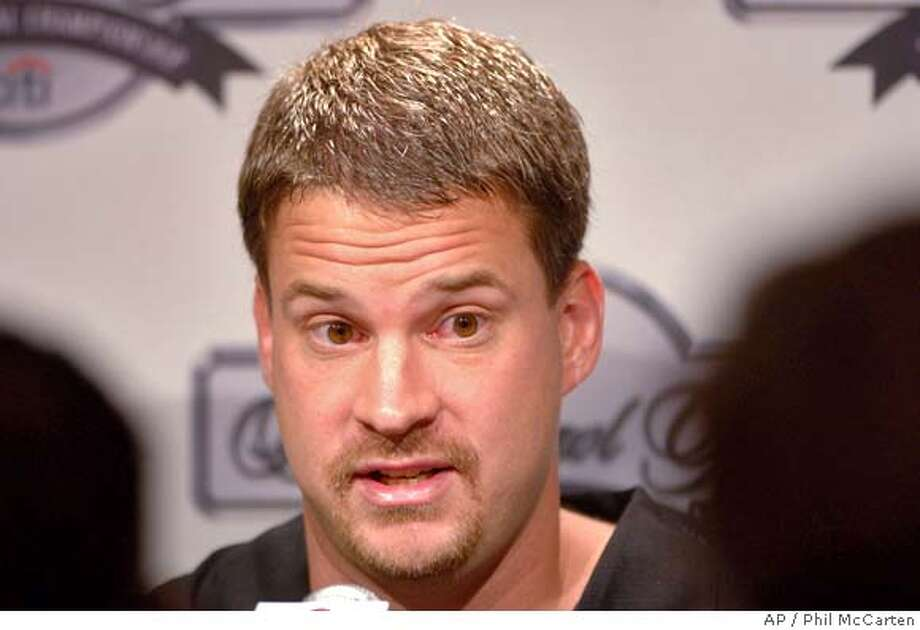 Southern California offensive coordinator Lane Kiffin answers questions at a news conference Sunday, Jan. 1, 2006 at the Beverly Hilton Hotel in Beverly Hills, Calif. The University of Texas and Southern California compete for the national championship in the Rose Bowl on Jan. 4, 2006. (AP Photo/Phil McCarten) Photo: PHIL MCCARTEN