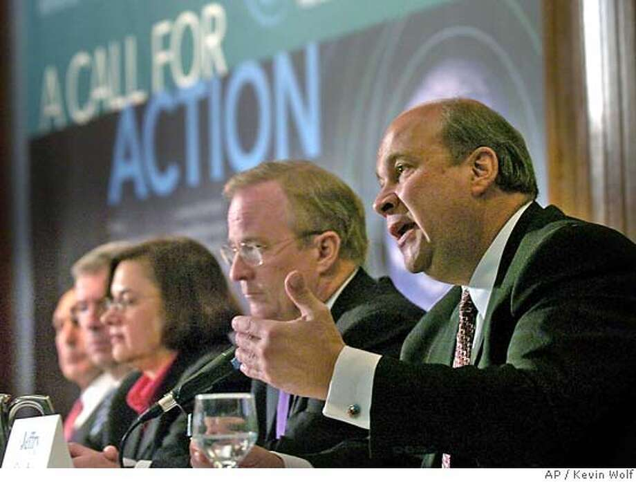 �Jeffery Sterba, with PNM Resources, right, speaks at a news conference at the National Press Club in Washington, Monday, Jan. 22, 2007. The chief executives of 10 major corporations, on the eve of the State of the Union address, urged President Bush to support mandatory reductions in climate-changing pollution and establish reductions targets. From right are, Sterba, Peter Darbee of PG&E Corp, Eileen Claussen with Pew Center on Global Climate Change, Jim Owens of Caterpillar, Inc., and Richard Fuld, Jr. of Lehman Brothers Holdings Inc. (AP Photo/Kevin Wolf) Photo: KEVIN WOLF
