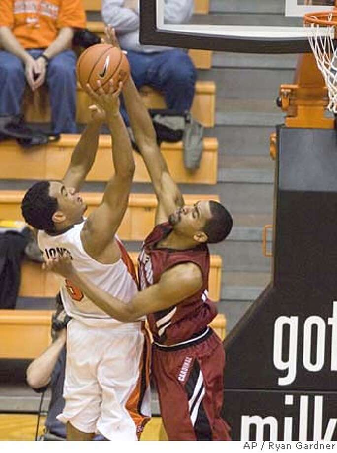 Stanford's Lawrence Hill, right, blocks the shot of Oregon State's Marcel Jones during the second half of a basketball game in Corvallis, Ore., Saturday, Jan. 20, 2007. Stanford won 67-56. (AP Photo/Ryan Gardner) Photo: Ryan Gardner