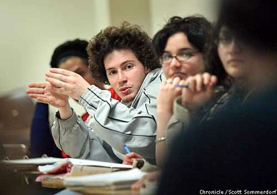 S.F. State student Jonah Copi makes a point during the lively discussion in Matthew Shenoda's Arab Literature class. The class was very engaged in this discussion that ranged from the media's coverage of the war with Iraq, to the meaning of a student's art piece that depicted the confict over oil. To the right is student Kenza Oumlil (cq). SF CHRONICLE PHOTO BY SCOTT SOMMERDORF Photo: Scs
