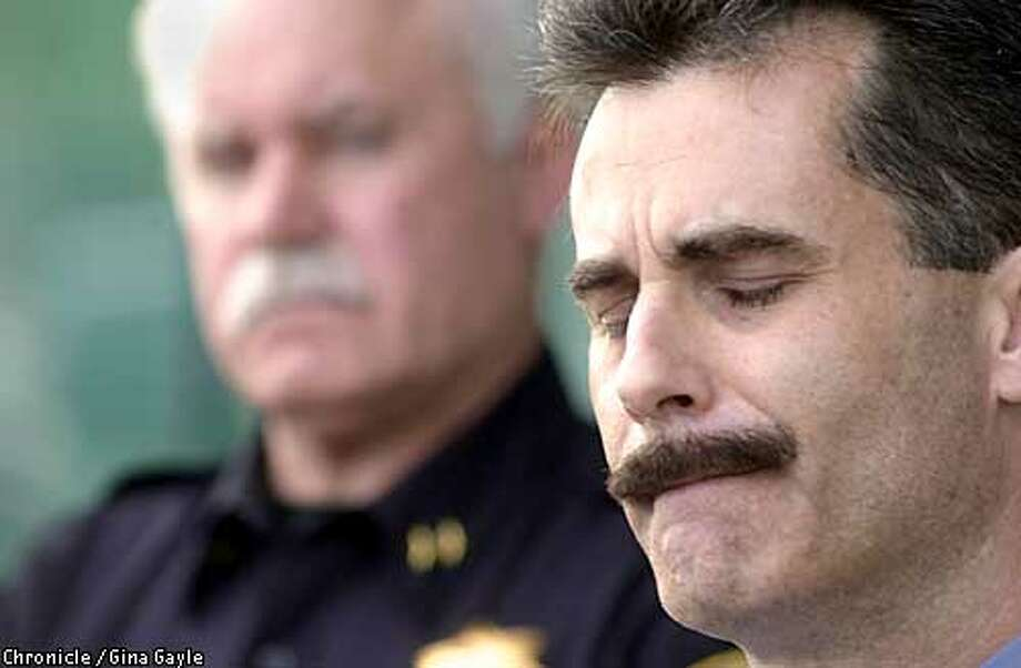 Lt. Dan Terry of the Contra Costa County Sheriff's department gets emotional during a press conference giving details of the shooting death of Pittsburg police Inspector Ray Giacomelli who was shot and killed earlier in the day at a home on Abbott Avenue in Pittsburg. Behind him is Pittsburg Police Chief Aaron Baker. Photo by Gina Gayle/The SF Chronicle. Photo: GINA GAYLE