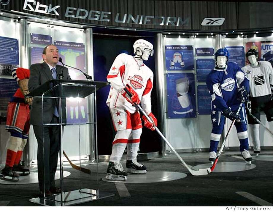 National Hockey League commissioner Gary Bettman addresses the media as he helps introduce the new NHL uniform , seen in red and blue, during a press conference in Dallas, Monday, Jan. 22, 2007. (AP Photo/Tony Gutierrez) Photo: Tony Gutierrez
