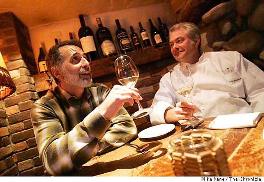 "011707_ONTHETOWN_MORGAN0134_MBK.JPG  Jeff Morgan, left, and friend Todd Humphries, chef and co-owner of Martini House, share a bottle of a light-bodied white wine at Martini House, one of Morgan's favorite local haunts, in St. Helena, CA, on Wednesday, January, 17, 2007. Morgan is the author of ""The Plumpjack Cookbook: Great Meals for Good Living."" A Northern California-based author and winemaker, Morgan is also the former West Coast editor of The Wine Spectator and has written ""Dean & DeLuca: The Food and Wine Cookbook"" and ""Rose: A Guide To The World's Most Versatile Wine."" photo taken: 1/17/07  Mike Kane / The Chronicle ** Jeff Morgan, Todd Humphries MANDATORY CREDIT FOR PHOTOG AND SF CHRONICLE/ -MAGS OUT Photo: MIKE KANE"