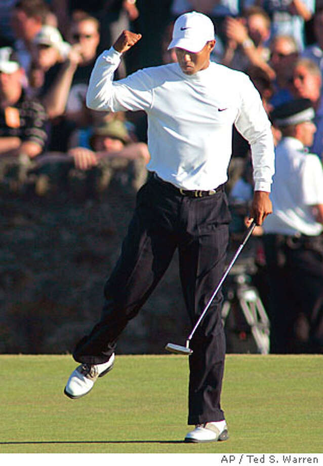 Tiger Woods of the United States reacts as he makes par on the 17th green during the third round of the championship on the Old Course at St. Andrews, Scotland Saturday July 16, 2005. (AP Photo/Ted S. Warren) Photo: TED S. WARREN