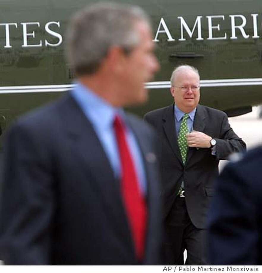 Chief presidential adviser Karl Rove, right, follows President Bush, left, as they prepare to board Air Force One Friday, July 15, 2005 at Andrews Air Force Base. Rove testified to a grand jury that he talked with two journalists before they divulged the identity of an undercover CIA officer but that he originally learned about the operative from the news media and not government sources, according to a person briefed on the testimony. (AP Photo/Pablo Martinez Monsivais) Photo: PABLO MARTINEZ MONSIVAIS