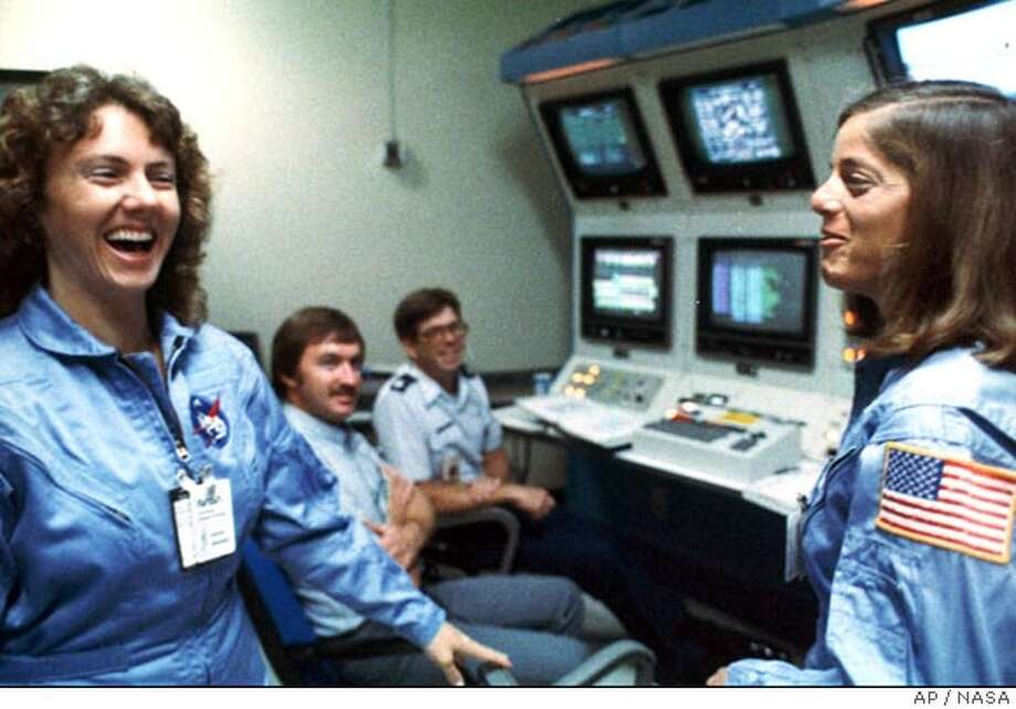 FILE--Christa McAuliffe, left, and Barbara Morgan, right, laugh with each other during training in in the months before the Challenger mission. Sixteen years after Christa McAuliffe and six other astronauts died in the Challenger explosion, NASA announced Friday, April 12, 2002, that McAuliffe's fellow teacher and one-time understudy Barbara Morgan will ride aboard a shuttle in 2004.(AP Photo/NASA)  Ran on: 01-22-2007  Left, Christa McAuliffe (left) and Bar- bara Morgan (right) train together in late 1985 and early 1986. This summer, Morgan, top, is set to ride the shuttle.  Ran on: 01-22-2007 Photo: X