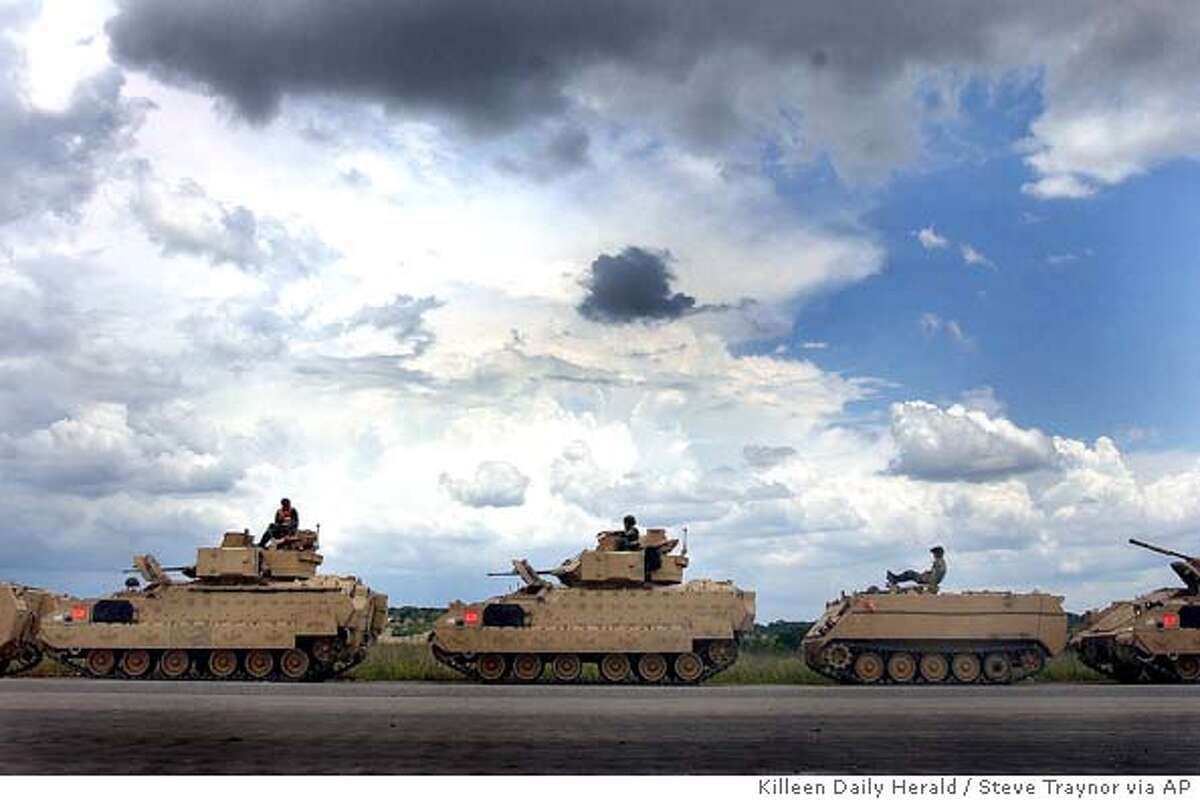 Tank drivers from the 3th Battalion, 67th Armored, 4th Infantry Division wait for long hours to begin the process of moving out their M1 tanks from the staging area to the railhead for transport at Fort Hood, Texas, on Tuesday, July 5, 2005. The division is preparing their equipment for redeployment to Iraq this fall. (AP Photo/Killeen Daily Herald, Steve Traynor)