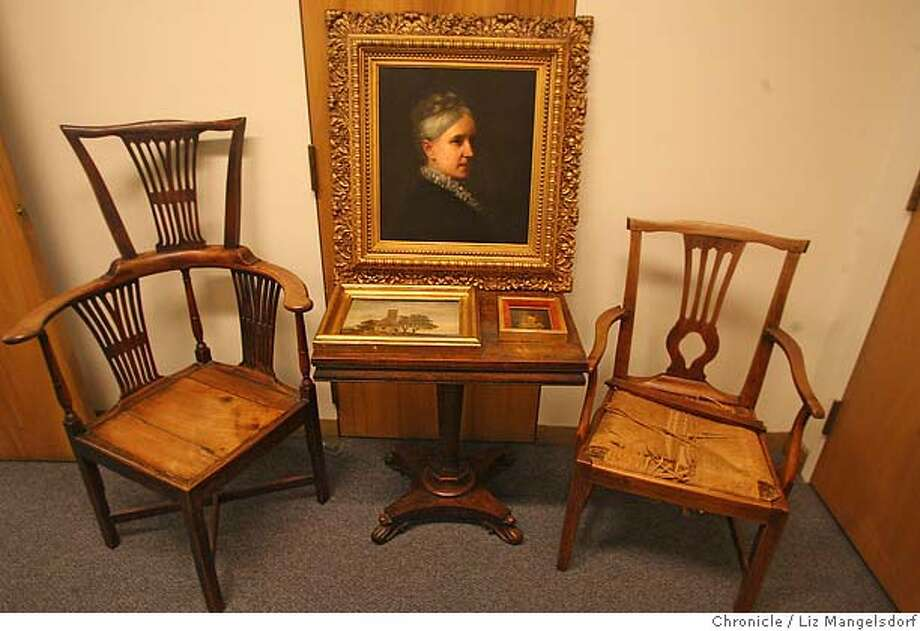 The recovered stolen painting, valued at $1 million, center, with the other recovered stolen property, including 2 other paintings and two antique chairs. Photographed in the Hall of Justice, Burglary division on Jan. 22, 2007.  Liz Mangelsdor/San Francisco Chronicle Photo: Liz Mangelsdorf