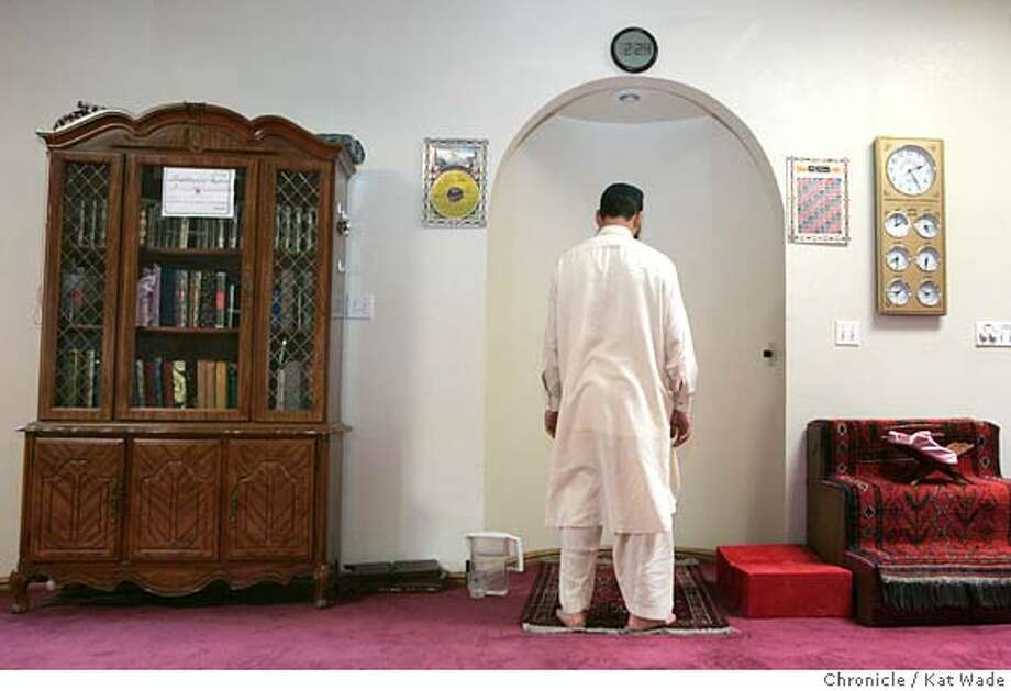 LODIMOSQUE_009c_KW.jpg  On 7/14/05 in Lodi after the 2:00 prayer at the Lodi Muslim Mosque, an Muslim(WHO DOES NOT WANT TO BE IDENTIFIED) wearing a traditional salwar kameez, must remove his shoes before entering the mosque for the five daily prayer times that are lead from the arch in both Arabic and Urdu the Pakistani language, the Koran, wrapped in pink silk sits on a carved stand on the right. The mosque is at the center of the contoversy over the building of a Muslim School and gained media attention when the mosque's Imam was taken and held for immigration issues. Kat Wade/ The Chronicle MANDATORY CREDIT FOR PHOTOG AND SF CHRONICLE/ -MAGS OUT Photo: Kat Wade