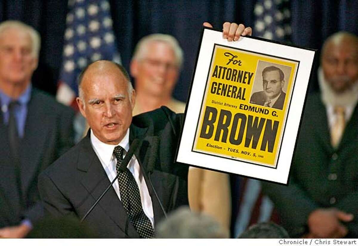 gov08_0163_cs.jpg Newly-elected attorney general Jerry Brown holds up a 1946 campaign poster from when his father Pat Brown ran for the same office. Leading Democrats, including Dianne Feinstein, Jerry Brown, Barbara Boxer and Bill Lockyer attend a Democratic Party election night rally at Delancey St. Restaurant, Town Hall Rm., 600 Embarcadero, San Francisco. Chris Stewart / The Chronicle Ran on: 11-08-2006 At a rally at Delancey Street Restaurant in San Francisco, Jerry Brown, leading in the race for state attorney general, shows a 1946 campaign poster for his father, Pat Brown, who won the same office. Ran on: 11-08-2006 MANDATORY CREDIT FOR PHOTOG AND SF CHRONICLE/ -MAGS OUT