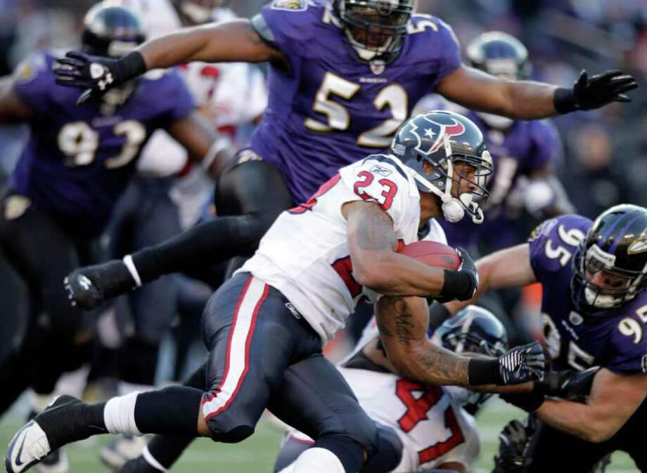 Running back Arian Foster (23) shows the Ravens' defense why he's such a keeper for the Texans. Long-term deal or not, he's a likely lock to stay put. Photo: Brett Coomer / © 2012  Houston Chronicle