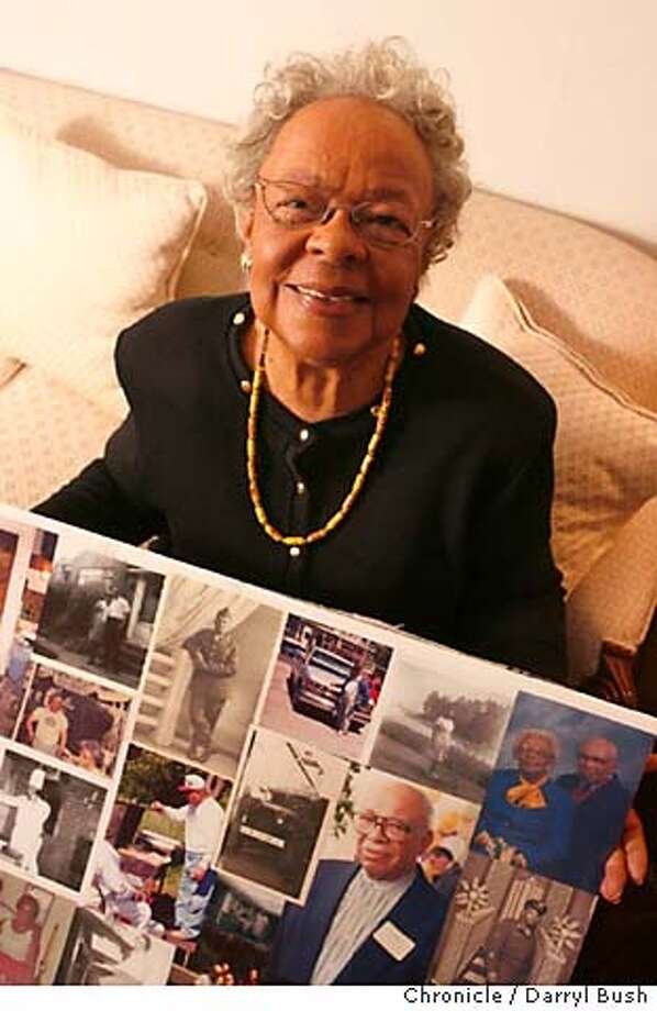 JA_Earp_037_db.JPG  Jefferson award profile, Geraldine Earp, 86, holds photos of her family history including many photos of her and her husband, Garland Earp, in her home in San Francisco, CA, on Friday, January, 12, 2007. photo taken: 1/12/07  Darryl Bush / The Chronicle ** Geraldine Earp, Garland Earp (cq) MANDATORY CREDIT FOR PHOTOG AND SF CHRONICLE/ -MAGS OUT Photo: Darryl Bush