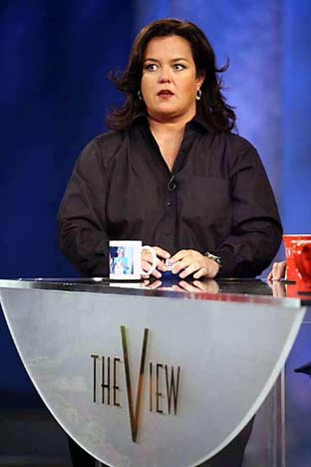"""**FILE** Rosie O'Donnell, fills the moderator slot on """"The View"""" during the taping of the first show of the 10th season of the ABC women's talk show in this Sept. 5, 2006, file photo, in New York. She started a war of words with Donald Trump when she said on the show Wednesday,Dec. 20, 2006, that Trump's news conference with Tara Conner had annoyed her """"on a multitude of levels."""" Trump said Tuesday at a news conference in New York that he would allow Conner, the current Miss USA accused of underage drinking, to keep her title if she settled down and entered alcohol rehab. (AP Photo/Mary Altaffer, file)  Ran on: 12-22-2006  Rosie O'Donnell questions Trump's &quo;moral compass.&quo; SEPT. 5, 2006, FILE PHOTO Photo: MARY ALTAFFER"""