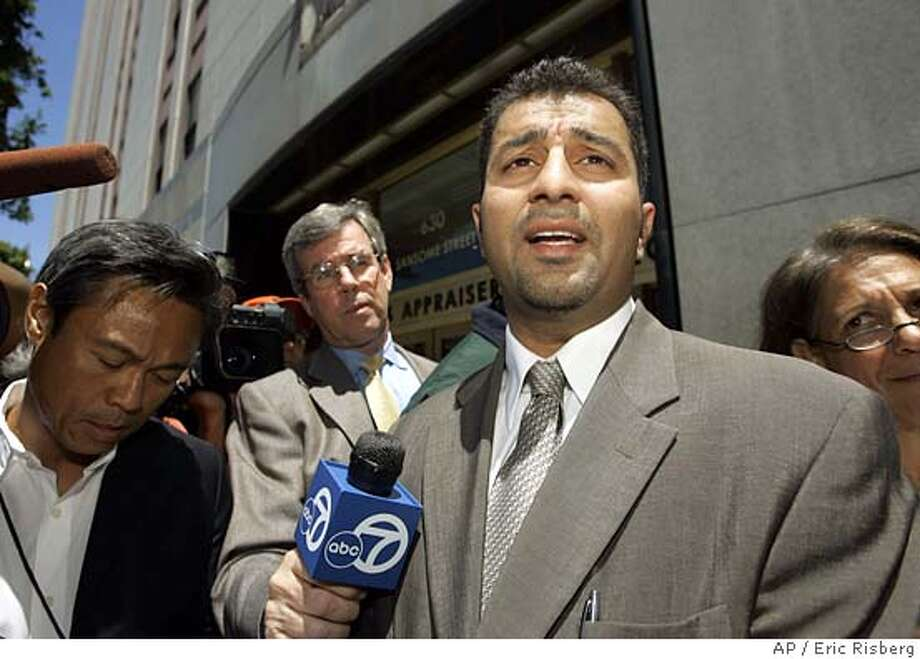 Saad Ahmad, an attorney for three Lodi, Calif., imams, answers questions after two of his clients agreed to be deported, outside a federal immigration office building in San Francisco, Friday, July 15, 2005. An Islamic religious leader held on immigration charges as part of an investigation into terror activity in the agricultural community of Lodi agreed Friday to be deported to Pakistan along with his son. Muhammed Adil Khan and his 19-year-old son, Mohammad Hassan Adil, admitted to overstaying theirvisas. In exchange, immigration authorities dropped other allegations that the two misrepresented themselves to obtain religious visas. Ahmad adamantly denied his clients had any connection to terrorism.(AP Photo/Eric Risberg) Photo: ERIC RISBERG