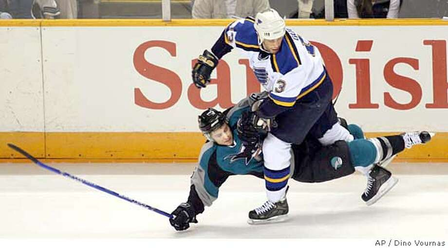 San Jose Sharks' Josh Gorges, left, and the St. Louis Blues' Bill Guerin collide in the first period of an NHL hockey game, Saturday, Jan. 20, 2007, in San Jose, Calif. (AP Photo/Dino Vournas) Photo: Dino Vournas