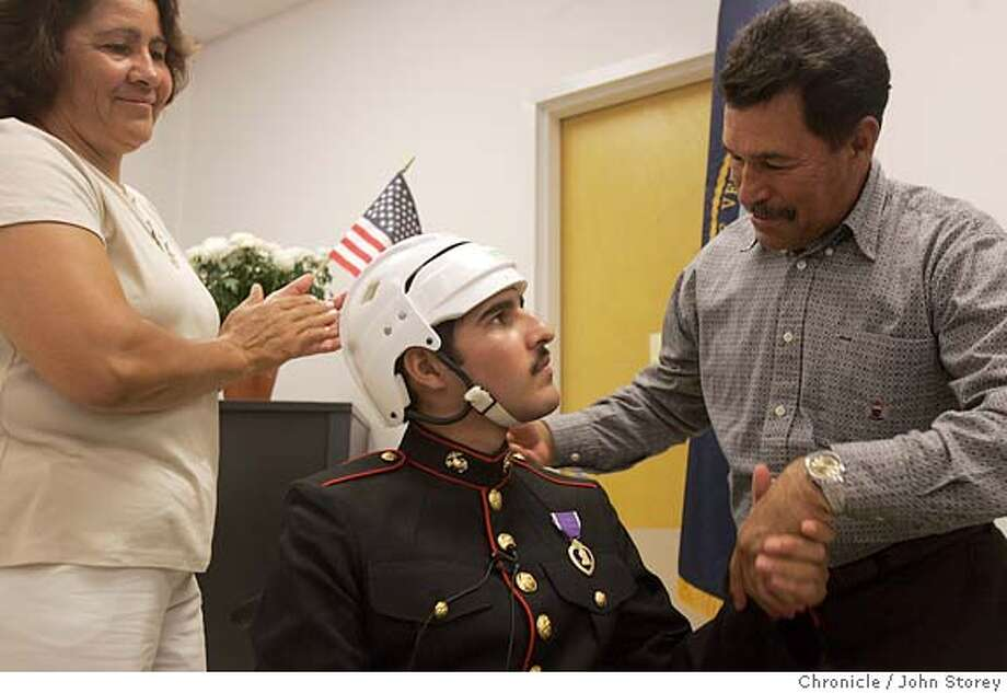 Gomez_jrs_0161.jpg  Angel Gomez is congradulated by his father, Antonio Gomez after Angel became a citizen. His mother Paulino Gomez looks on. Angel Gomez becomes a US citizen after being wounded in Iraq. He was sworn into citizenship at the VA hospital in Palo Alto. John Storey Palo Alto Event on 7/14/05  - MANDATORY CREDIT FOR PHOTOG AND SF CHRONICLE/ -MAGS OUT Photo: John Storey