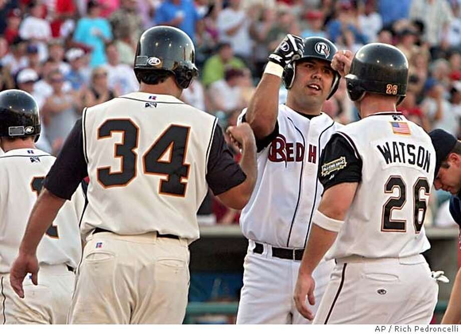 Pacific Coast League All-Star catcher Gerald Laird, center, receives congraulations at home plate from All-Star teammates Connor Jackson, left, and Matt Watson, right, after Laird hit a grand slam during the bottom of the first inning against the International League All-Stars during the Triple-A All-Star game played at Raley Field in West Sacramento, Calif., Wednesday, July 13, 2005.(AP Photo/Rich Pedroncelli) Photo: RICH PEDRONCELLI