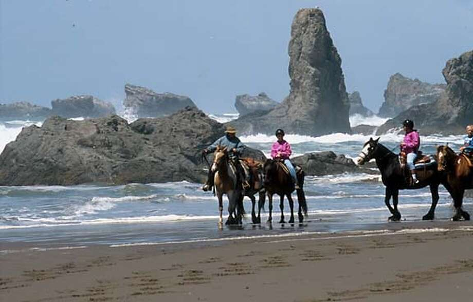 A horseback ride along the crags at Bandon Beach. Photo by Rikke Jorgensen, special to the Chronicle