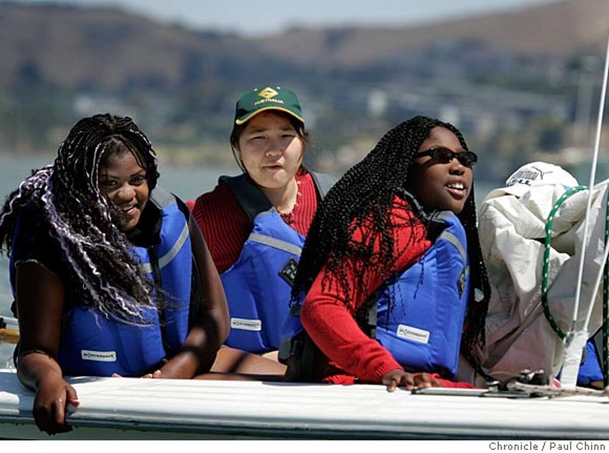 Janine Wiggins, Saran Luvsanjambaa (cq) and Renika Jackson enjoyed their sunny day on Richardson Bay. Marin County kids learn how to sail with the True Youth sailing outreach program on 6/21/05 in Sausalito, Calif. The program is a learn-to-sail program for underprivileged kids who have never been on the water. PAUL CHINN/The Chronicle